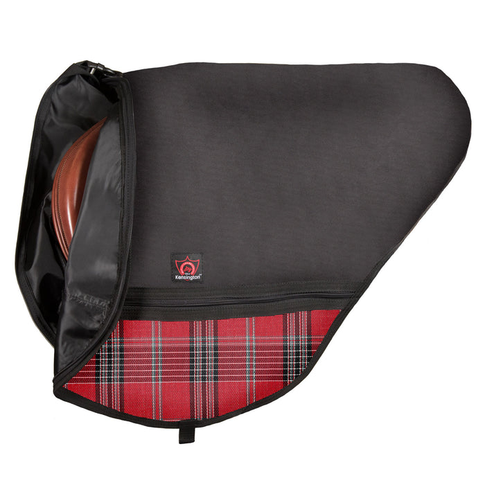 Black saddle bag with adjustable strap. Red plaid textilene pockets. Bag open partly to reveal nylon liner and english saddle inside. Zippers and clips shown