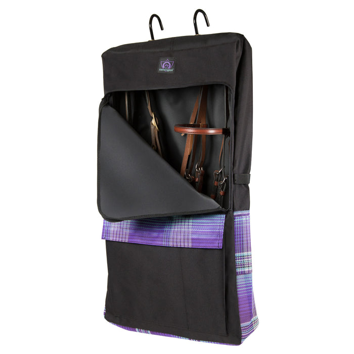 Black bridle bag with purple, and blue plaid pockets. Shown with hooks on top, pockets on the front and two sides.