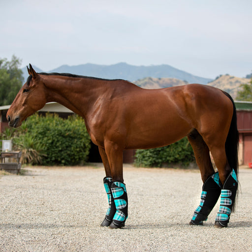 Turquoise and black trailering shipping boots.