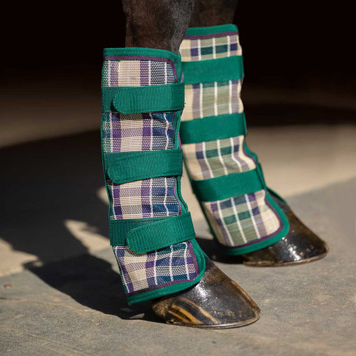 Tan plaid and hunter green color fly boots with web trim