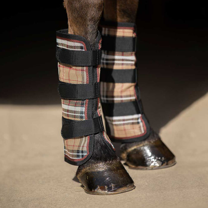 Tan plaid and black color fly boots with web trim