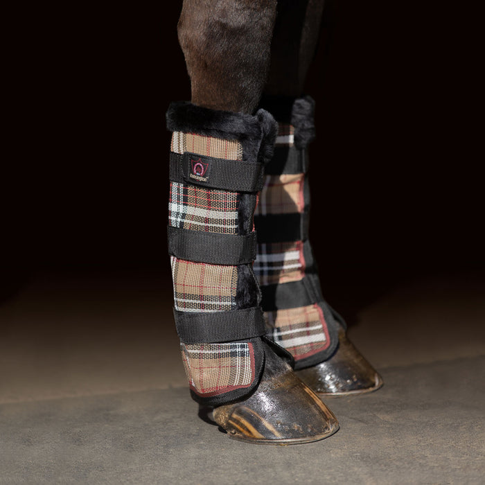 Tan plaid and black color fly boots with fleece trim