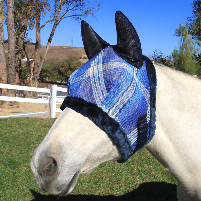 Kensington fly mask with fleece trim and ears. 73% UV protection. Blue plaid with navy trim and ears.