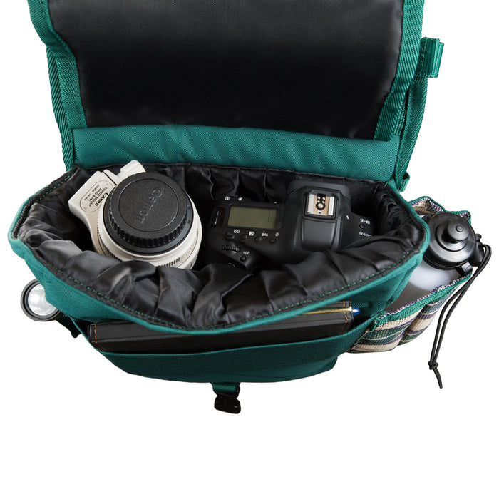 hunter green insulated western saddle bag with bottles, shown with camera and lens inside