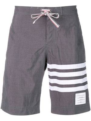 THOM BROWNE MEN CLASSIC BOARD SHORT IN SOLID SWIM TECH W/ 4 BAR PRINT