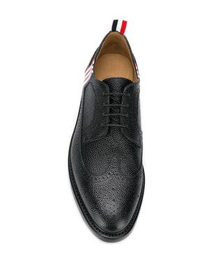 THOM BROWNE MEN CLASSIC LONGWING BROGUE WITH 4 BAR RWB EMBOSS AND LEATHER SOLE IN PEBBLE GRAIN