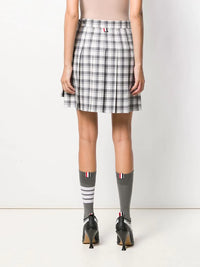 THOM BROWNE WOMEN DROPPED BACK MINI PLEATED SKIRT IN DOUBLE TATTERSALL CHECK WOOL SUITING