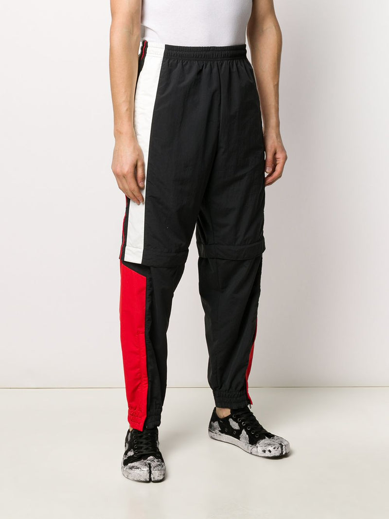 VETEMENTS MEN ZIP OFF TRACKSUIT TROUSERS