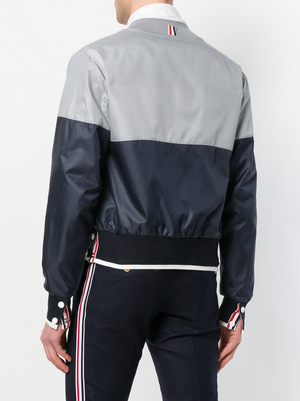 THOM BROWNE MEN BICOLOR 1/2 AND 1/2 BOMBER W/ TIPPING STRIPE IN RIPSTOP