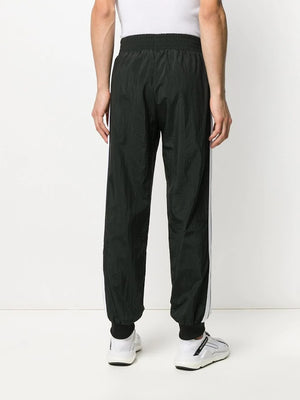 PALM ANGELS MEN OVER LOGO TRACK PANTS