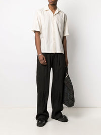 ZIGGY CHEN MEN CREASED BOTTOM PLEATED WIDE-LEG TROUSERS