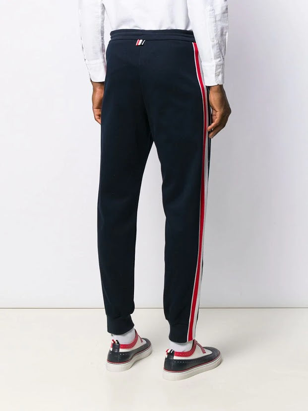 THOM BROWNE MEN TRACK PANTS WITH RWB STRIPE IN INTERLOCK