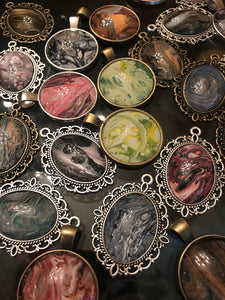 One of a Kind Necklace pendants made from the drippings of an original painting by Shanna Koltz.