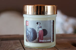 """Strength of a Woman,"" art by Shanna Koltz on a Soy candle with crackling wooden wick in a 10oz Glass Jar with a shiny lid"