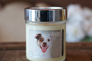 """Happy,"" art by Shanna Koltz on a Soy candle with crackling wooden wick in a 10oz Glass Jar with a shiny lid"
