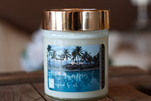 "Load image into Gallery viewer, ""Tropical Vacation,"" art by Shanna Koltz on a Soy candle with crackling wooden wick in a 10oz Glass Jar with a shiny lid"
