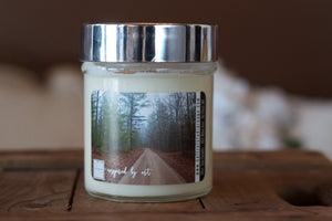 """The road ahead,"" art by Shanna Koltz on a Soy candle with crackling wooden wick in a 10oz Glass Jar with a shiny lid"