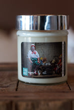 "Load image into Gallery viewer, ""The lonely clown,"" art by Shanna Koltz on a Soy candle with crackling wooden wick in a 10oz Glass Jar with a shiny lid"