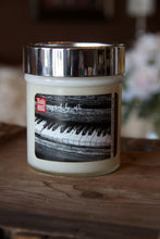 "Load image into Gallery viewer, ""The love of music,"" art by Shanna Koltz on a Soy candle with crackling wooden wick in a 10oz Glass Jar with a shiny lid"