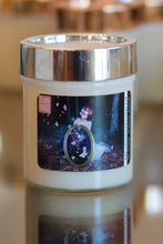 "Load image into Gallery viewer, ""Letting Go,"" art by Shanna Koltz on a Soy candle with crackling wooden wick in a 10oz Glass Jar with a shiny lid"