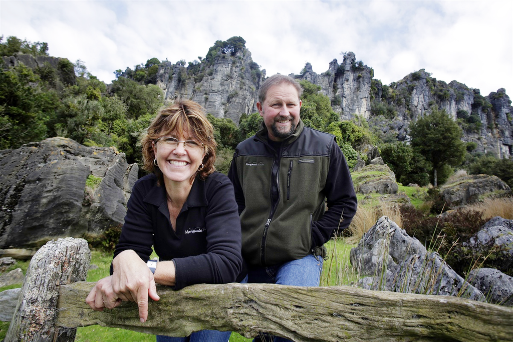 Suzie and Warrick Denize in front of the limestone formations. Image credit: The Waikato times.