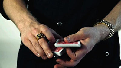 Closeup of hands cutting the deck of cards