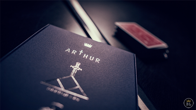Closeup of Arthur packaging with deck of cards in the background