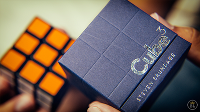Closeup of Cube 3 box with actual solved cube in the background