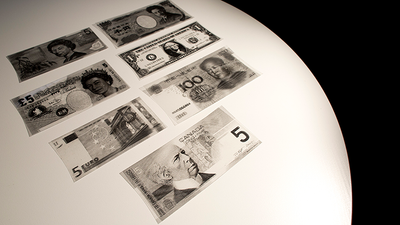 InvisiBill examples in different currencies sitting on a table.