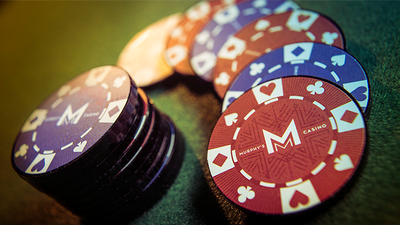 Closeup of stack of poker chips with a fan of alternating chips beside