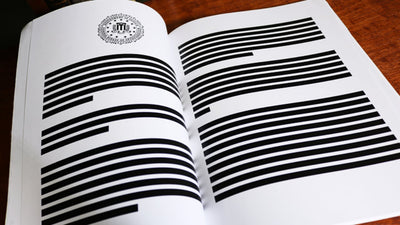 Mueller Report open, fully redacted