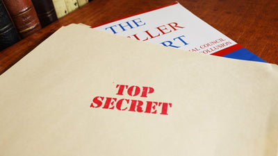 Mueller report sticking out of top secret folder