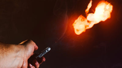 Medium closeup from hand side of a fireball launching from the Pyro Pen