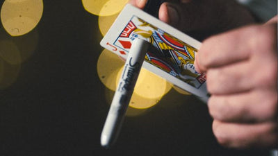 Closeup of Quantum being performed. Sharpie is through jack of spades, as seen from the bottom of the card
