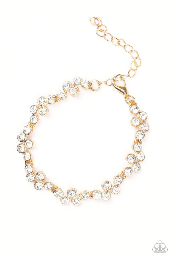 Paparazzi Still GLOWING Strong - Gold - White Rhinestones - Gorgeous Timeless Bracelet - Lauren's Bling $5.00 Paparazzi Jewelry Boutique