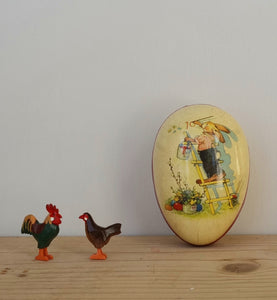 Mini rooster and hen in an egg