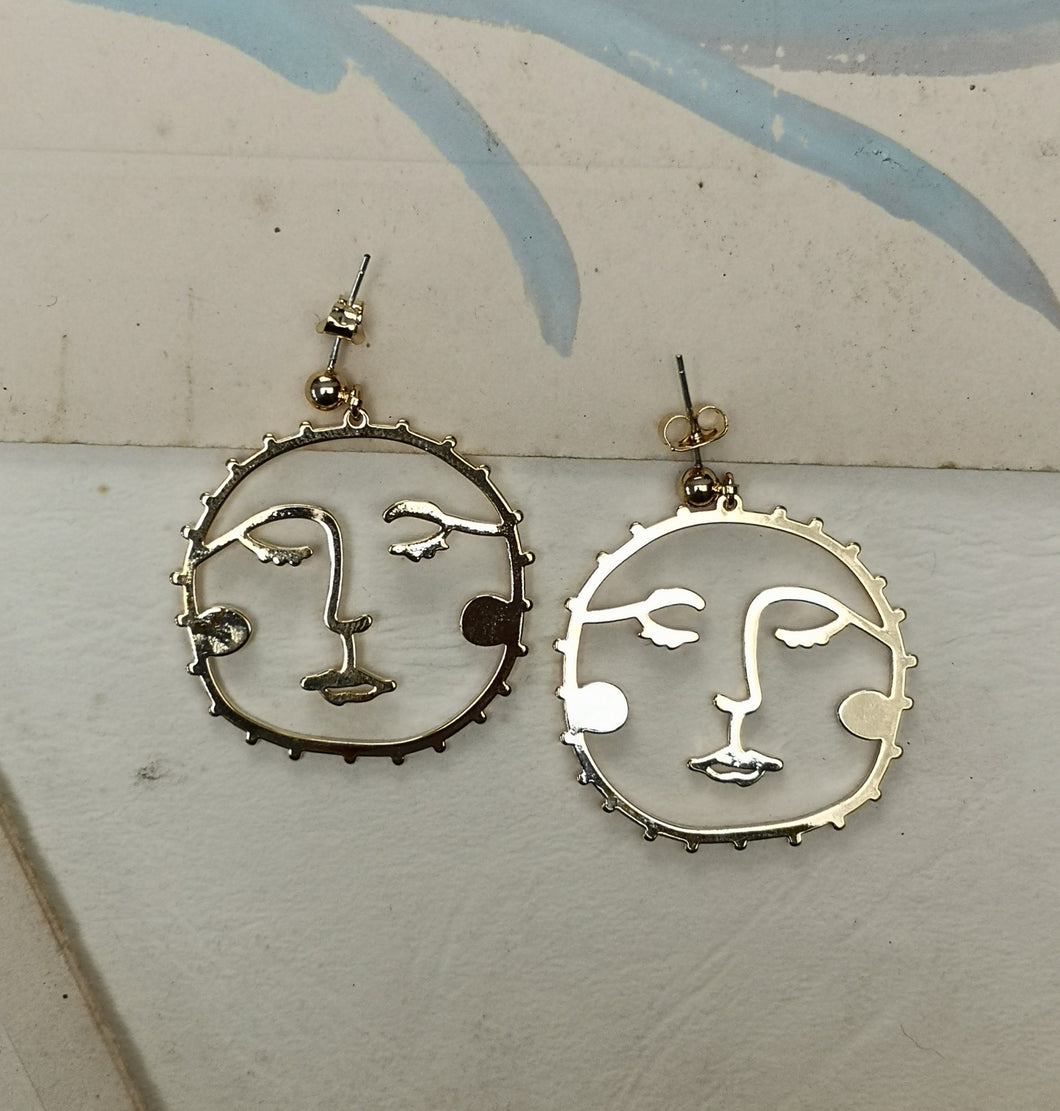 Gold sun face earrings