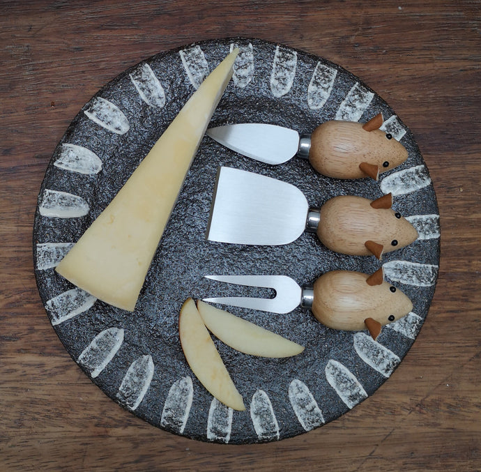 A set of 3 little cheese knives