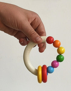 Wooden half moon and bead rattle