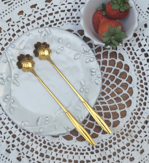 Pair of long gold spoons