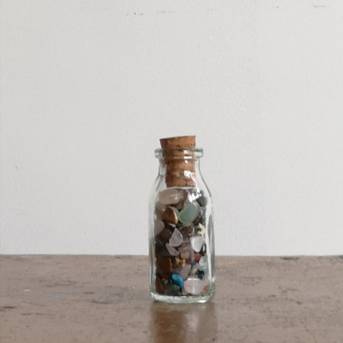 Mini gemstones in a  bottle