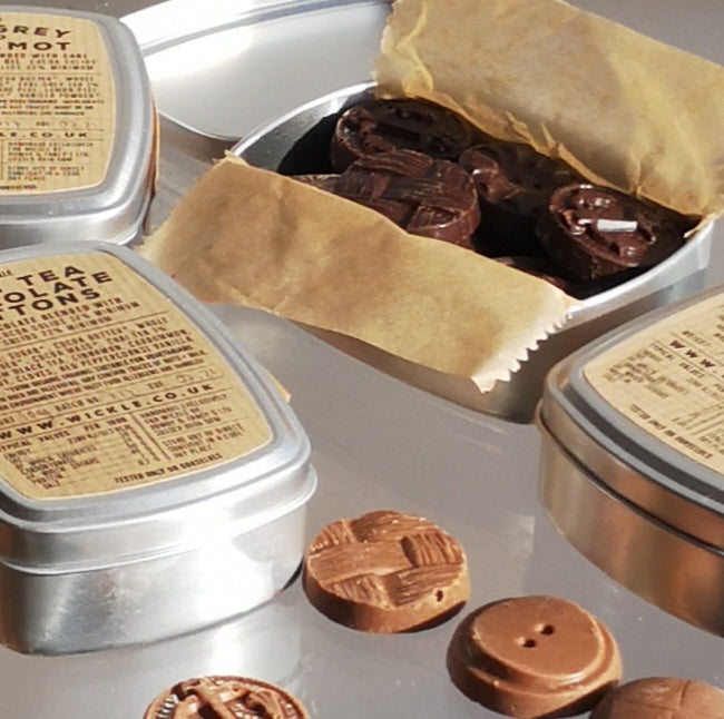 Tin of flavoured chocolate buttons.