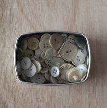 A tin of buttons