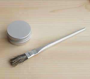Small aluminium brush