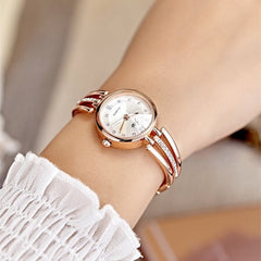 Stainless steel women luxury watch. With diamond details. - up-wrist