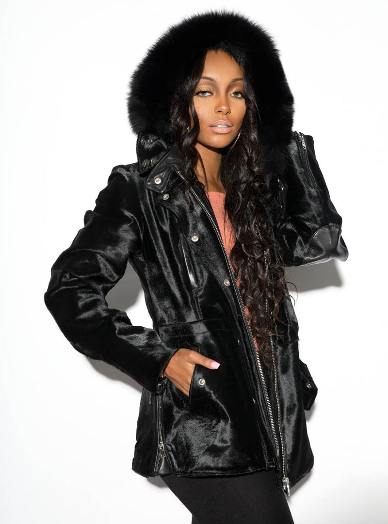 cowhide leather jacket with raccoon fur trimmed hood