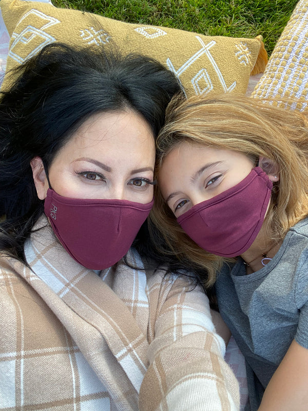 Woman and daughter wearing face masks