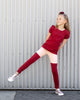 Load image into Gallery viewer, Girl wearing a gathered short-sleeve burgundy coloured tee and ruched leggings that are blush pink from the waist to the thigh and burgundy from the thigh to the ankle.