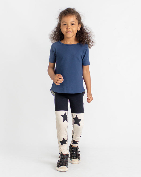 Navy coloured short-sleeve tee and ruched leggings with a star-print shown on a girl.