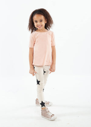 Blush pink coloured short-sleeve tee and star-printed leggings shown on a girl.
